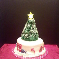 Christmas Tree  Three layer white cake with peppermint buttercream filling. Tree is made from RKT and covered with individual heart shaped fondant pieces...