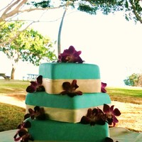 "Aquare Hawaiian Wedding Cake Banana Cake with chocolate hazelnut filling. This cake looked a lot better before I set it up at the venue, but the ""breeze"" was..."
