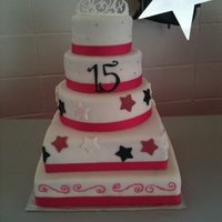 1St Quinceanera Cake My largest cake so far! White 5 tier red velvet and coconut cakes covered in white fondant. Decorations are fondant and buttercream with...