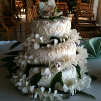 Hawaiian Wedding 3 tier wedding cake, vanilla cake w/ chocolate ganache filling and buttercream decoration. Bride provided the entwined leis for the cake....