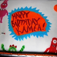 Yo Gabba Gabba! Sheet Cake Chocolate fudge sheet cake with strawberries & cream filling. Everything is hand made and edible. My first (and last) character cake.