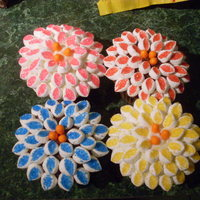Chrysanthemums Mini marshmallows cut in half and the sticky side dipped in colored sugar.