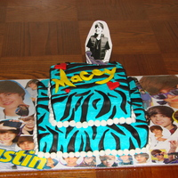 Justin Beiber Cake Made for a little gir's birthday. She loves Justin Beiber. It's buttercream icing with MMF decorations. The Justin topper is is...