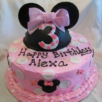 Minnie Cake pink and white minnie mouse cake. Ears and dots are made of fondant.