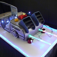 Delorean Back To The Future Cake I made this for a fundraiser last weekend. The car has lights and sound effects! The cake weighed 85 pounds. There is a scrolling message...