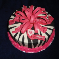 "Happy Birthday Cassidy!  10"" Smooth BC - white cake with seedless red raspberry, fondant bow, heart and stripes, edible pearls. Large white heart for Mom and..."