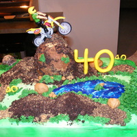 Dirt Biking Over The Hill  For our friends surprise 40th birthday who loves dirt bikes! cake is vanilla & choc.w/ oreo cream filling, top is crushed oreos and...