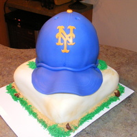 Ny Mets On Base All Fondant...used wilton ball pan...needed to wait longer for brim to dry..it started to droop. My friend was still happy with it! I hope...