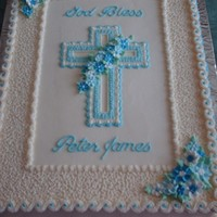 First Communion/baptism Cake   Cake frosted and decorated in buttercream with royal icing flowers.