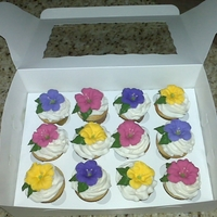Petunia Cupcakes I make these for my business customers. They love it when I call on them for business. BC frosting with RI petunias.