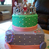 Princess Cake This was for an Ariel birthday party. The cake is devil's food with chocolate fudge icing in the center and bc frosting on the outside...