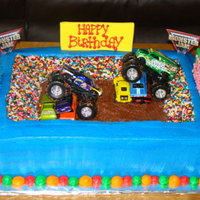 "Monster Truck Made this for my nephew. French vanilla with bc. Fondant signs and sprinkles for the ""ppl"". He loved it! TFL!"