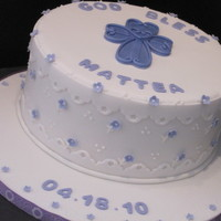 1St Communion Cake is covered in fondant with gumpaste flowers. Elegent and girly just as they asked.