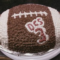Football Cake Made this for a little boy who plays football at Dundee Central School...chocolate cake with chocolate buttercream frosting