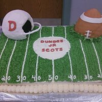 Football Cake Cake I made for a little league banquet...covered in buttercream. Helmet and football are rice krispies covered in fondant