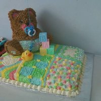 Teddy Bear Baby Shower Cake Made this for a baby shower...half sheet cake (half chocolate/half vanilla) decorated to look like a quilt, teddy bear is pound cake and...
