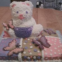 Bear And Butterflies Baby Shower Cake For a baby shower...3D bear is made out of rice crispies, butterflies are made out of chocolate melts. Half sheet cake is half vanilla,...