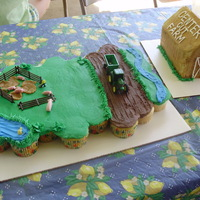 Farm Birthday my son asked for a farm/tractor cake like he does every year! the barn is shaped from loaf pans and the farm scene is a cupcake cake. we...