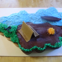 Camping Cupcake Cake the boy having a campout birthday party asked specifically for a snake and a canoe on the cake! i always have fun w/ cupcake cakes. the...