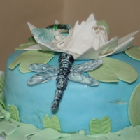 Water Lily Cake This is a cake I did for one of my Final Wilton Classes. Fondant and Gumpaste with gumpaste dragonflies and water lily.