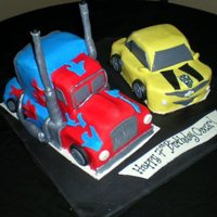 Transformer 3D Car Cake   This was super fun and challenging! Optimus Prime and BumbleBee in their car form:)