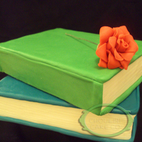 Stacked Books Cake Stacked books with a small gumpaste rose