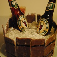 Beer Bucket Cake WASC with chocolate MMF filled with fireball whisky cream filling. Gelatin ice cubes and sugar beer bottles...it was sooo fun to make, can...