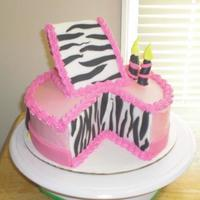 Zebra Slice Cake Rainbow cake with strawberry buttercream icing. Fondant decorations. This was my first attempt at this style of cake. I thank all the CCers...