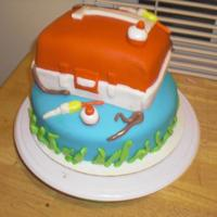 Fishing Cake mixture of wilton fondant and mmf covering and decorations.