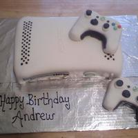Xbox Cake Fondant covered cake with RKT controllers. Thanks to all who have previously done this cake and proved to be great examples to work from.