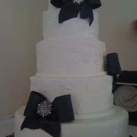 Black And White Wedding   huge cake, with lace apliques and bows, and real broaches provided by bride.