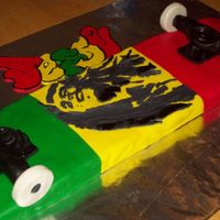 Bob Marley Skateboard Cake This was for a friends son who I think came up with this to test me. All is made with MMF....Bob Marley is gumpaste. I copied a real...