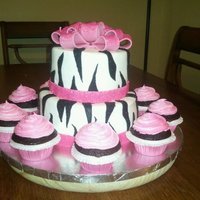Pink Zebra Cake Top tier is strawberry, bottom tier is vanilla, and cupcakes are chocolate. TFL