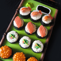 Sushi Mini Cakes Made these sushi mini cakes for my best friends birthday. All the elements are made with fondant, piping gel, sprinkles, and cake! :)