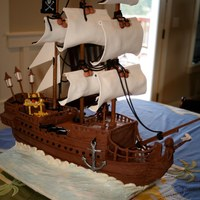 "Pirate Ship Birthday Cake - Black Pearl Birthday cake themed after the ""black pearl"" ship. Made from cake, modeling chocolate and gumpaste. The only inedible product are..."
