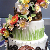 Gumpaste Flowers And Branches Wedding Cake Nature inspired wedding cake with modeling chocolate branches supporting the gumpaste flowers. Medallion was painted with vodka and petal...