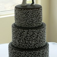 Chocolate Lover's Dream  This is a chocolate cake filled with chocolate ganache and covered with dark chocolate fondant. Scrollwork was all free hand and took a...