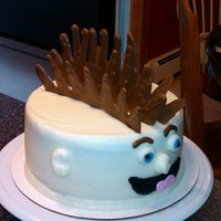 Mohawk Cake For my son's 7th birthday. The mohawk is made of chocolate. TYFL!