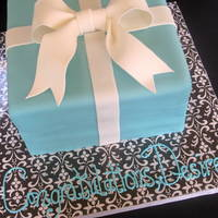 Tiffany Box Cake Vanilla butter cake with Nutella frosting. Second time doing a gift box cake...they are truly a challenge for the perfectionist...
