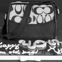 Coach Purse Cake Surprise cake for my [OLD] sister ;)Over the Hill cake (hence the gray and black theme) as a Coach purse...her fave ;)Fudge Brownie cake...