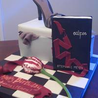 Twilight/shoebox Birthday Cake I made this cake for two friends with recent birthdays. One has an unabashed obsession with Twilight :) I styled the book, ribbon, board,...