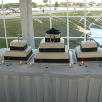 "Black And White Wedding Cake Trio  Three cake grouping, marshmallow fondant covered cakes with fondant ribbon, silver dragees, and fondant bow. Center cake 6"", 10&quot..."