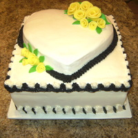 "Wedding Shower Yellow Roses Vanilla cake with vanilla icing, small single layer heart on a 10"" cake. MMF roses with black accents."