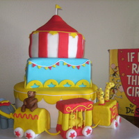 Dr. Suess Circus Cake My daughter's third birthday cake. Three layers with MMF decorations. The train cars were made from cereal treats and covered with...
