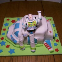Buzz Lightyear And His Ship Based off of Tandori's incredible Buzz Lightyear cake. Carved out of yellow WASC. Buzz is made out of fondant. Airbrushed with a pearl...