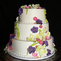 Beth's Bouquet Butter-cream icing with sugar-paste flowers. I ordered the moth orchids from Caljava, and dusted them with lime green luster dust.CSM: TFL...