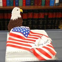 "I Pledge Allegiance Fondant flag draped over square cake. Eagle is colorflow, with ""feathers"" added using a leaf tip to over-pipe RI when the piece..."