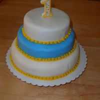 First Birthday Cake   This cake was for my son's first birthday. The cake is covered in rolled fondant.