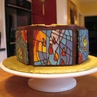 Stained Glass Cake Chocolate transfers to mimic the stained glass in our church. Hexagon shaped cake, each side with a different window, done to welcome our...