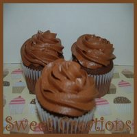 Swirl Cupcakes  Choc. cupcakes with choc swirl icing. Helicopter royal icing transfers on top. I used this recipe for the cake and icing. http://www....